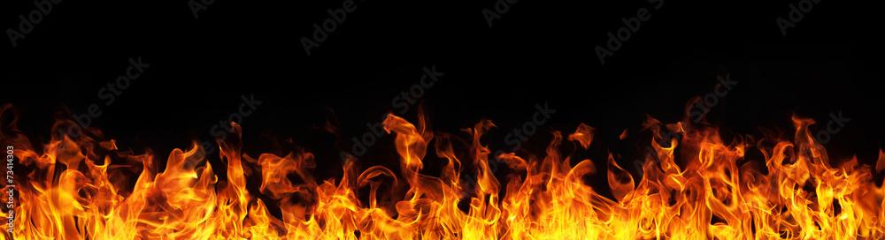 Fototapeta Fire flames on black background