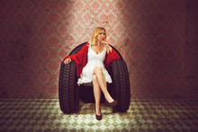 Young Woman In Armchair Made O...