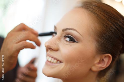 Fotografie, Obraz  Bride receiving make-up