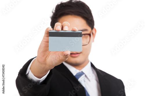 Fotografie, Obraz  Asian businessman show a blank card cover his face