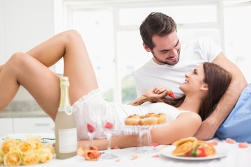 Obraz na płótnie Canvas Young couple having a romantic breakfast