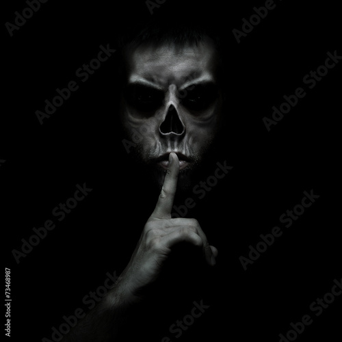 Fotografering Evil man gesturing silence, quiet isolated on black background