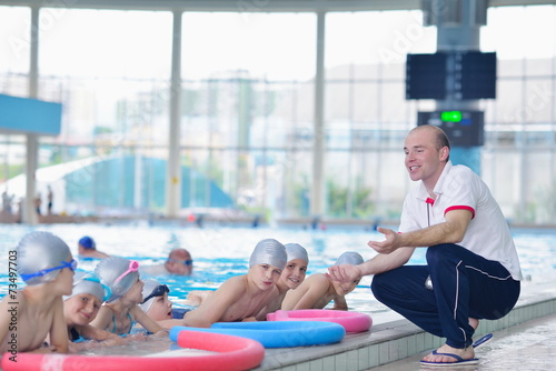 Fototapety, obrazy: group of happy kids children at swimming pool class learning to