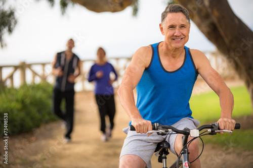 Fotografie, Obraz  People exercising outside in the summer