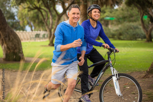Fotografie, Obraz  Elder couple exercising in the park