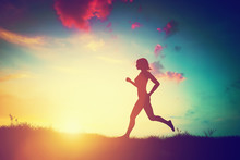 Silhouette Of Woman Running At...