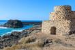 Stone fortress on El Cotillo beach, Fuerteventura island