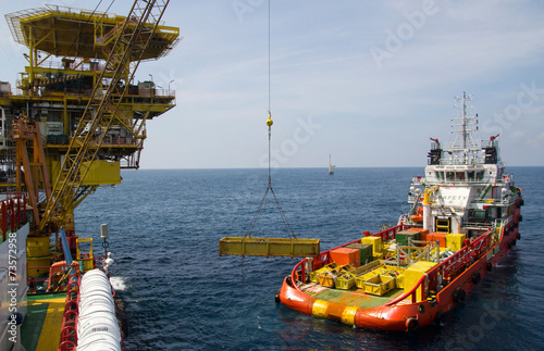 Fotografía  Close-up of a supply vessel transporting cargo to nearby rigs