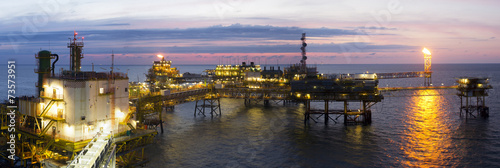 Staande foto Industrial geb. An offshore platform at sunset