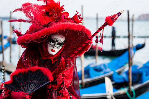 Woman in typical dress poses during Venice Carnival