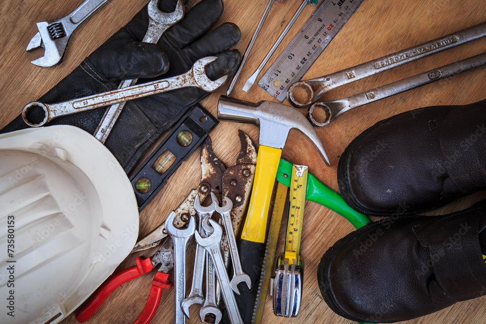 Closeup of assorted work tools on wood - obrazy, fototapety, plakaty