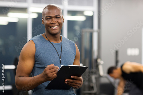 young african american male personal trainer Fototapeta