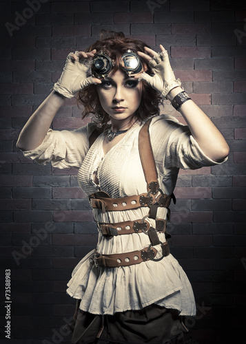 Photo  Redhair girl with steampunk goggles