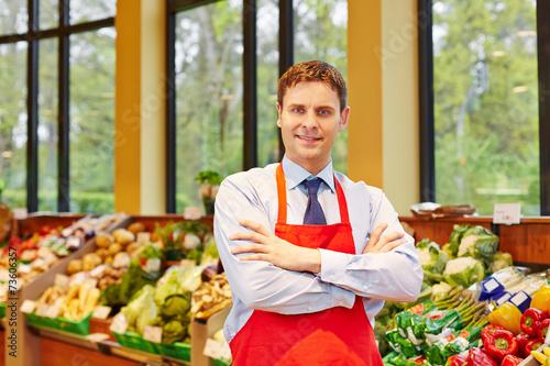 Fotografía  Marktleiter in einem Supermarkt
