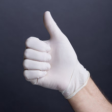 Male Hand In Latex Glove (thumb Up Sign)