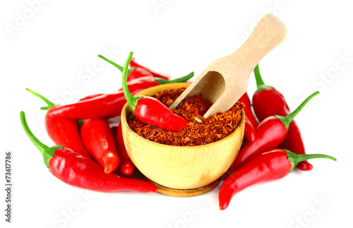 Photo Stands Herbs 2 Milled red chili pepper in wooden bowl isolated on white