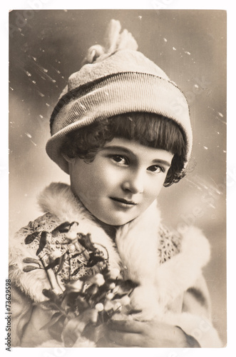 cute girl with christmas decoration and winter clothing