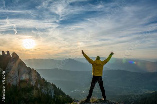 Fotografija  celebrating success in the sunset