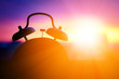 canvas print picture - alarmclock silhouette at sunrise cityscape