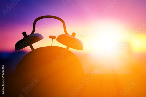 Poster de jardin Morning Glory alarmclock silhouette at sunrise cityscape