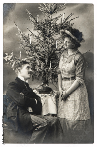 happy young couple celebrated with christmas tree