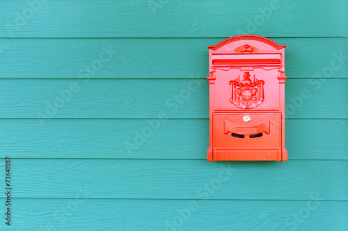 Fotografie, Obraz  Red mailbox with green wood background