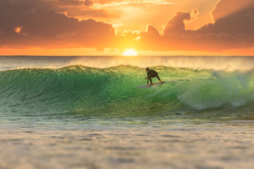 Fototapeta Surfer Surfing at Sunrise