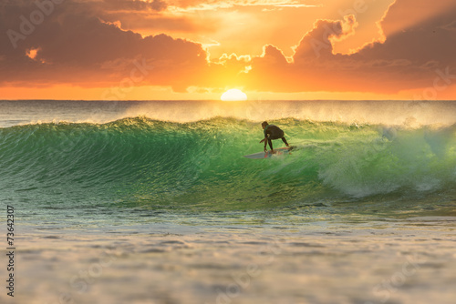 Surfer Surfing at Sunrise Canvas Print