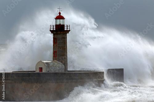 Huge wave over lighthouse