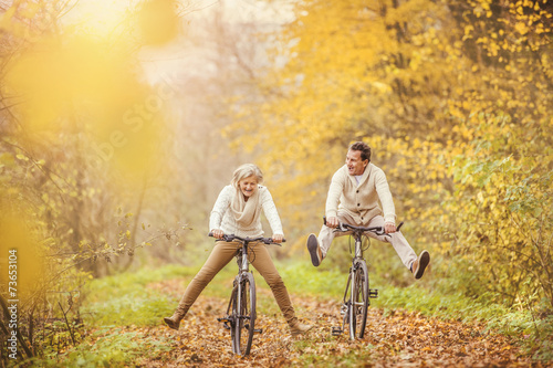 Fotografie, Obraz  Active seniors ridding bike and having fun