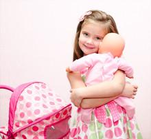 Cute Smiling Little Girl Playi...