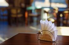 Paper Napkins On Dark Wooden Table