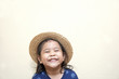 Portrait of little girl wearing a hat and smiling