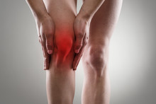 Tendon Problems On Woman's Leg Indicated With Red Spot.