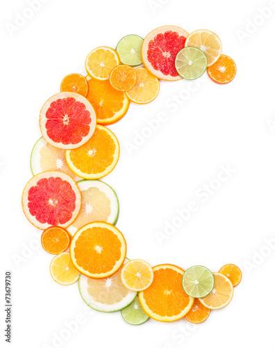 Fotografia  Vitamin C concept (letter C made of citrus slices)