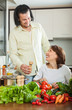 Couple with vegetables in the kitchen