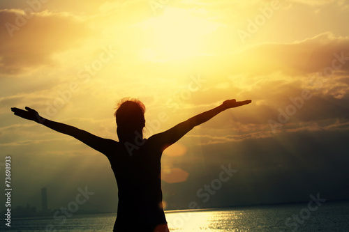 Fotobehang Draw cheering woman open arms at sunrise seaside