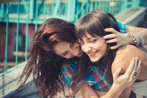 Valokuvatapetti beautiful hipster young women sisters friends