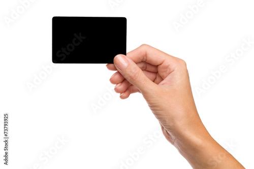 Fotografia  Czarna kartka w kobiecej dłoni