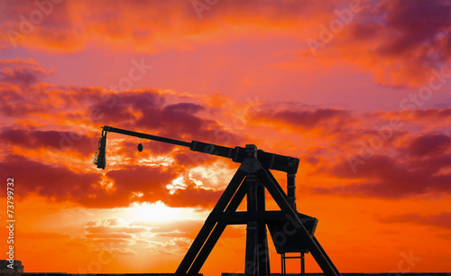 catapult silhouette under a red sunset Fototapeta
