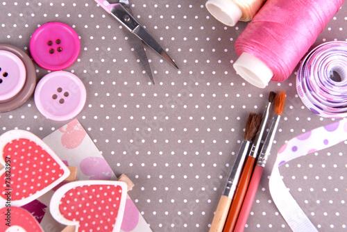 Foto  Scrapbooking craft materials on bright background