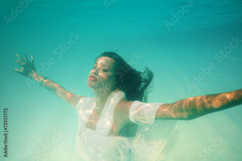Wall Murals Mermaid underwater girl in swimming pool