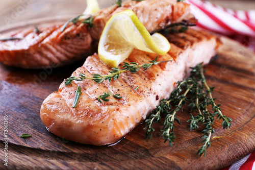 Fotografie, Obraz  Grilled salmon on cutting board on wooden background