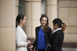 Three Businesswomen outdoors talking.