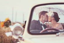 Bride And Groom In A Vintage Car