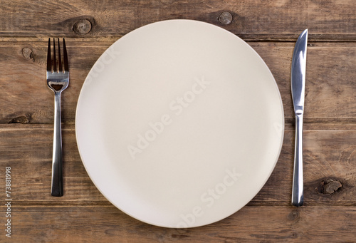 Fotografie, Obraz  Empty plate on wooden background