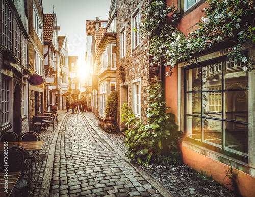 Foto op Aluminium Oude gebouw Old town in Europe at sunset with retro vintage filter effect