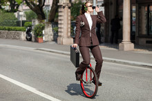 Portrait Of Businesswoman With Unicycle