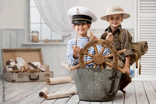 Vászonkép  Boys playing captain and traveler