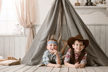 Boys As Indian And Cowboy Play...